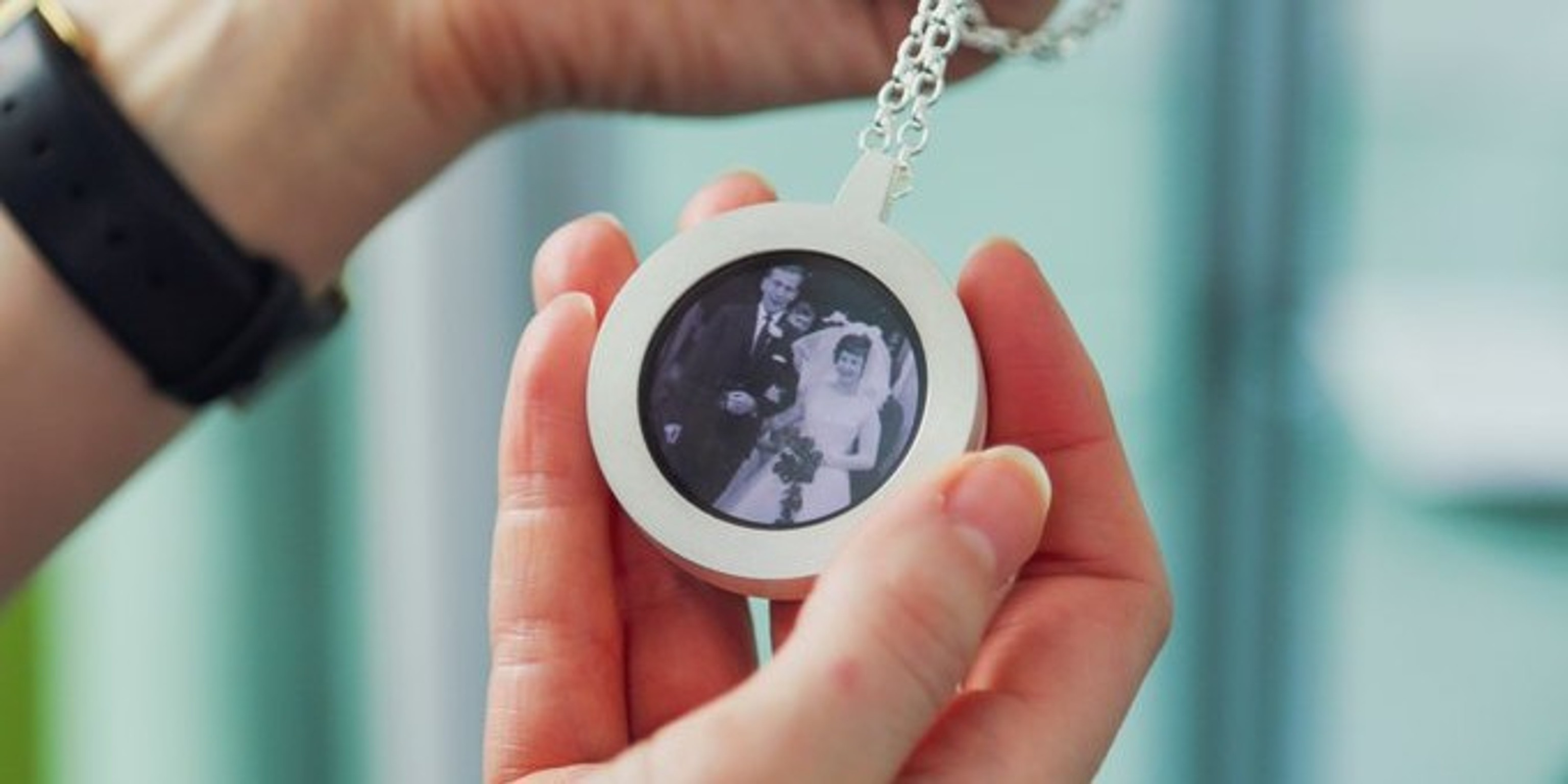 A digital locket containing photos of precious photos of the past and changing photos shared by family.